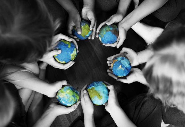 Kids holding the world in their hands